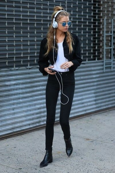 Model Stella Maxwell is spotted out and about in New York City, New York on September 3, 2016. She was rocking a black denim jacket with black jeans and had on white headphones.