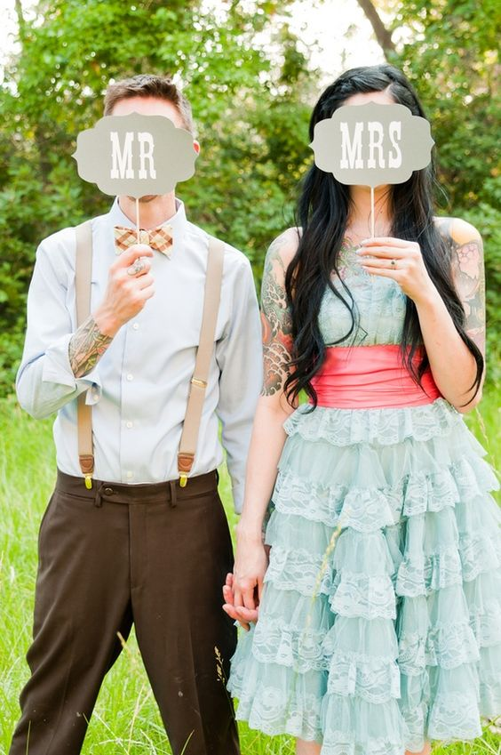 retro-modern wedding // one oak photography Cute posing and signs Trevor needs a plaid bowtie and suspenders,  dressing down a dressed up look.