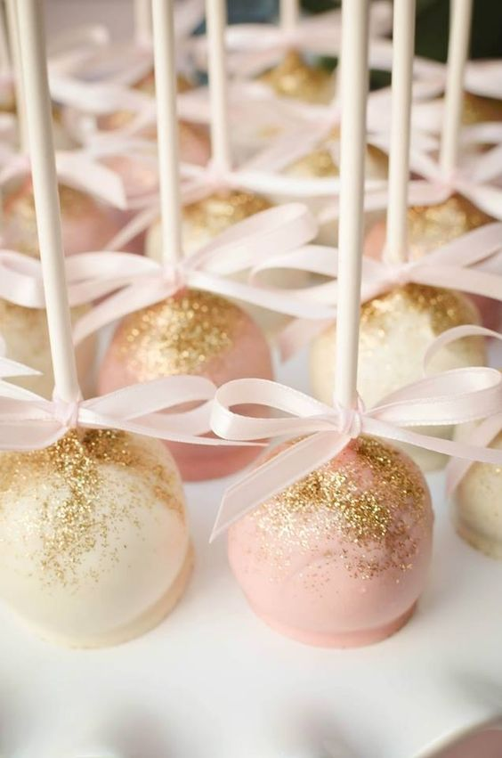 Pink and white cake pops dusted with gold edible glitter!: