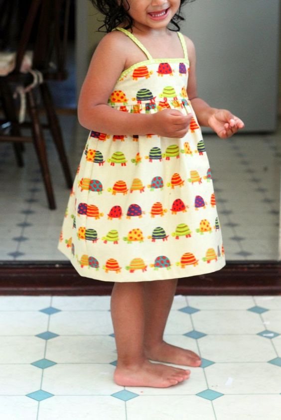 Simple Summer Dress for Girls - Follow this tutorial to learn how to sew a dress that will let her run and play in the summer sun. This free dress pattern only has four pieces, making it quick and easy for beginner sewists.
