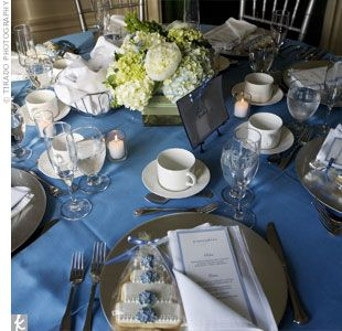 Cake And Punch Reception Decor : Crisp blue linens added a bright punch of color to the reception and were topped with square ...