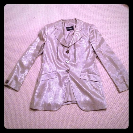 Giorgio Armani Black Label beige w glittery thread Gorgeous suit jacket from Giorgio Armani Black Label Collection. Three large buttons on the front one on each sleeve. This jacket is so classy and stylish. It sparkles because of the glittery thread. Made in Italy. Worn one time only. Offers accepted.  Giorgio Armani Jackets & Coats
