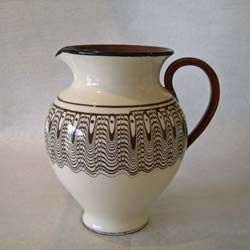 """This hand painted pitcher from Bulgaria is wonderful on its own, but simply spectacular when filled with artful blooms! 9"""" High, dishwasher safe"""
