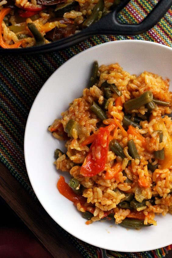 Clean out your fridge with this summer vegetable paella that allows you to use up all your crisper drawer odds and ends in a delicious one-pot meal.