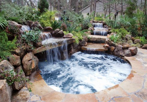 Love This Natural Setting Of The Waterfalls Over Rocks Into A Hot Tub I Ll Take It Hot Tub Outdoor Hot Tub Backyard Small Pool Design