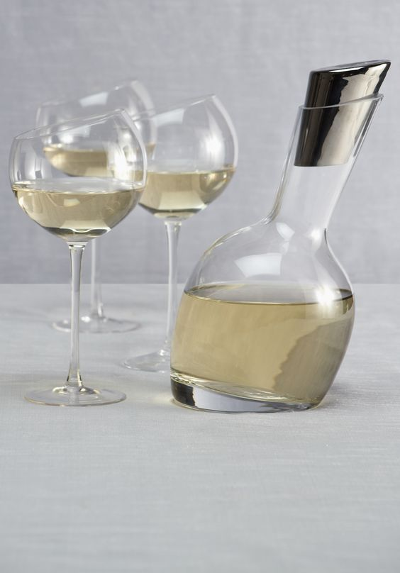 Streamlined contemporary design makes our chic Slant Decanter + glassware must-haves for your bar.