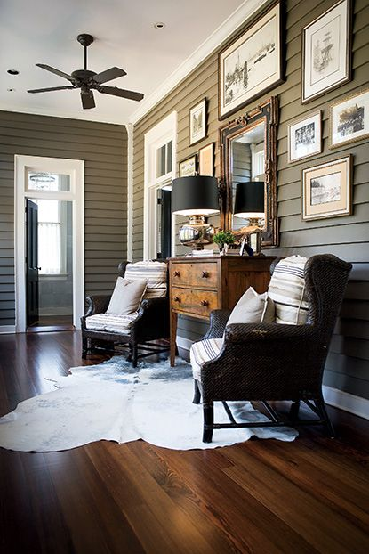 Family photos decorate the entry. #southernhomes #gardenandgun Photo Credit: Imke Lass.