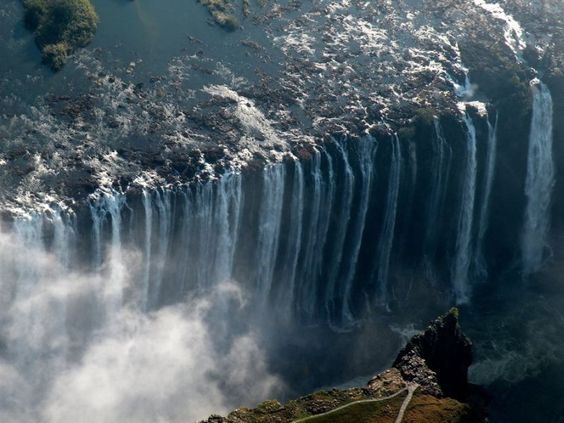 """Victoria Falls – Zimbabwe/Zambia  Victoria Falls, or Mosi-oa-Tunya, is located in southern Africa between the countries of Zimbabwe and Zambia. It was named after Victoria Queen in 1855 by David Livingstone, a Scottish explorer and missionary. Before that time the falls, were known as """"The Mist that Thunders."""" According to one of the lists of wonders it takes its place in the Seven Natural Wonders of the World. While it is neither the highest nor the widest waterfall in the world, it is one…"""