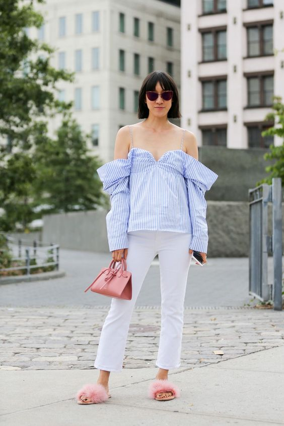 Off-the-shoulder is here too stay (furry sandals, too). #refinery29 http://www.refinery29.com/2016/09/120553/nyfw-spring-2017-best-street-style-outfits#slide-31: