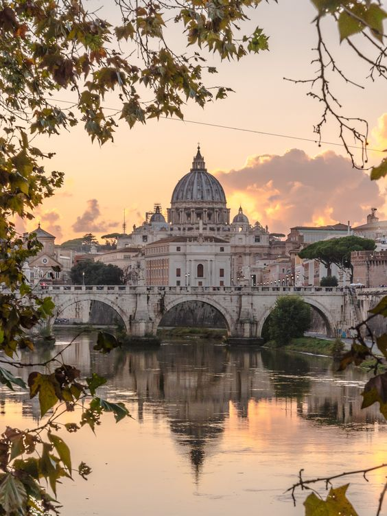 Scorcio della Basilica di San Pietro dal Lungotevere  Sunset | Rome | Best city breaks | Holiday | Reflection in the water | Beautiful point of view | Italia | Orange sky