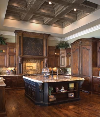 This kitchen design showcases how dramatic, hand-styled finishes and wood stains, as well as versatile custom cabinetry styles, can work together to bring a touch of Grand European Casual elegance.