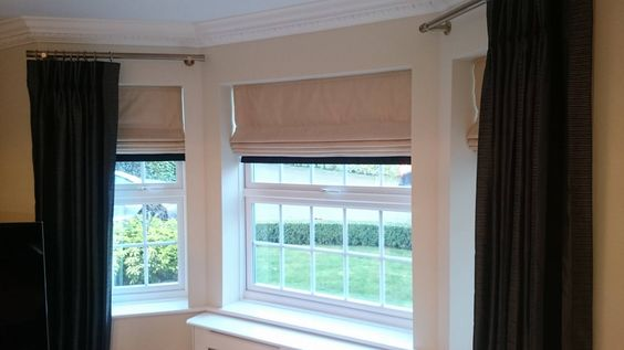 Monochrome curtains and roman blinds adding a border is a for Curtains and blinds together