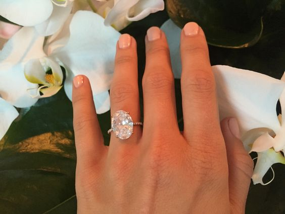 A classic, 5-plus-carat oval-shaped diamond, Lorraine Schwartz ring; Julianne Hough