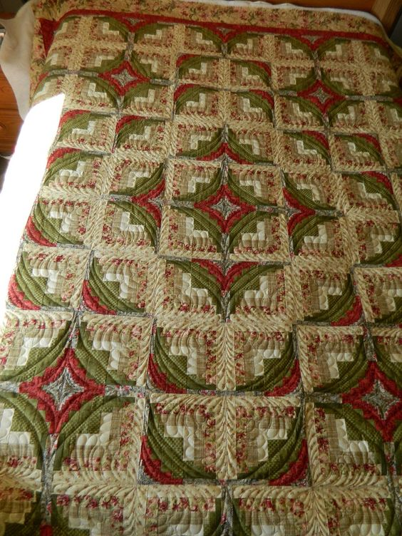 A Different Log Cagin - the piecing of this LC is unusual, but the curved quilting makes the ...