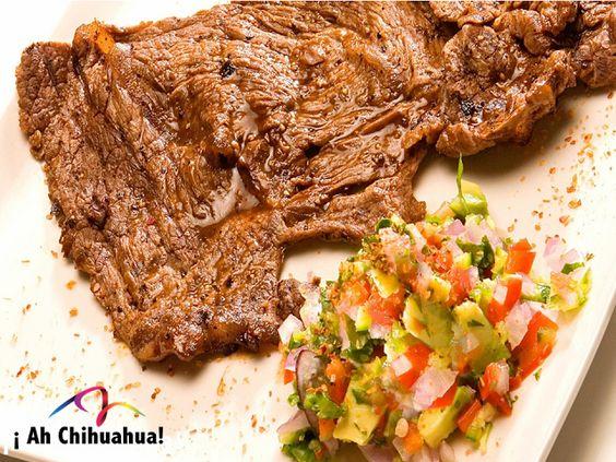 TURISMO EN CHIHUAHUA. Uno de los platillos típicos de Chihuahua es la carne asada, ideal para una tarde con amigos o familia. Este exquisito platillo se puede preparar al natural, pero es común que en la región sea marinada con cerveza, limón, sal, pimienta y acompañada con cebollitas de cambray, chiles toreados y papas al horno. Le invitamos a disfrutar del sabor único de la carne asada, que solo en Chihuahua es posible degustar. www.turismoenchihuahua.com. #visitachihuahua