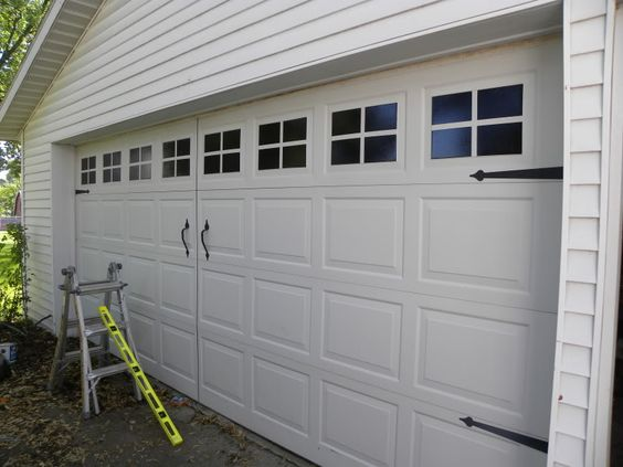 DIY Faux Carriage Garage Door. Do!  Rustoleum black gloss paint.