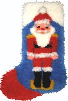 """Nutcracker Stocking. Finished size 12x17"""". Comes with easy-to-follow full color chart, 5-mesh canvas, 3 ply pre-cut acrylic rug yarn, and complete instructions. Backing fabric, finishing supplies,"""