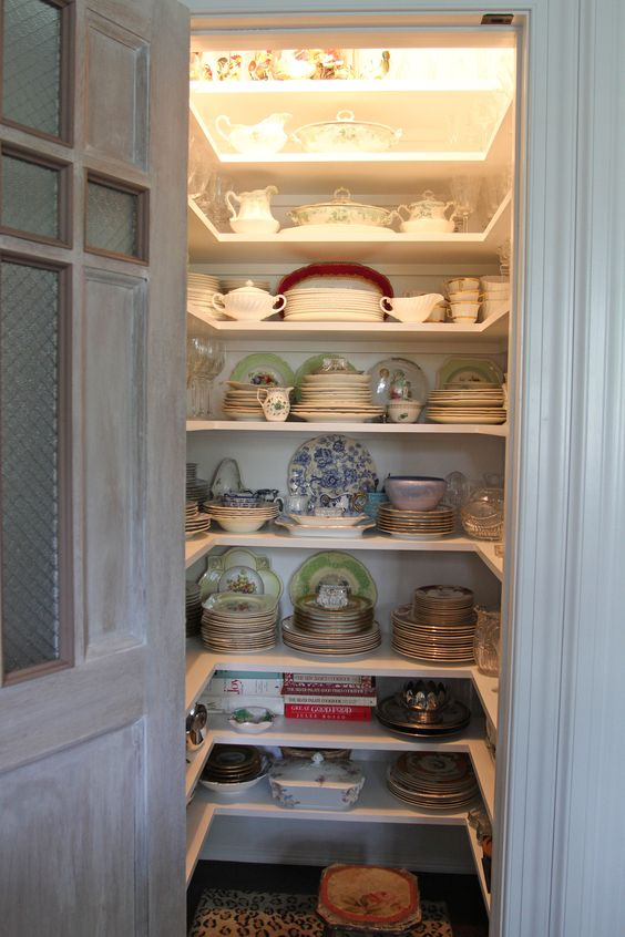 One of my pantries. The doors are antique doors from a church confessional that I limed and added the safety glass with chicken wire.