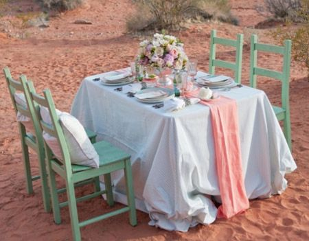 This soft coral and turquoise color scheme set against the orange desert is absolutely breathtaking. @ruffledblog @brushfire_photo #wedding #weddingtable
