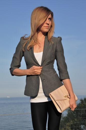 grey blazer and love the clutch... Casual Fridays.