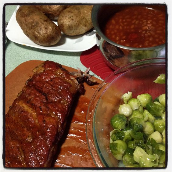 #chefdarrick makes BBQ ribs, brussel sprouts, baked beans, baked potatoes