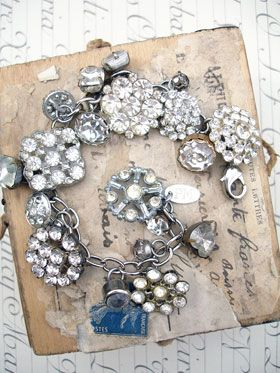 Vintage Rhinestone Button Bracelet Number 27  This bracelet has all vintage rhinestone buttons. There are so many different varieties and sizes, some with lacy bezels, some with clean setting and no prongs, some with gold tone settings, most with silver, all with various signs of age (which we love!)!..