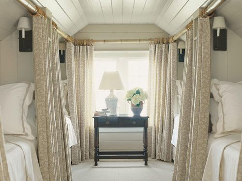 four cozy and curtained bunks in attic! Such a clever use of space.