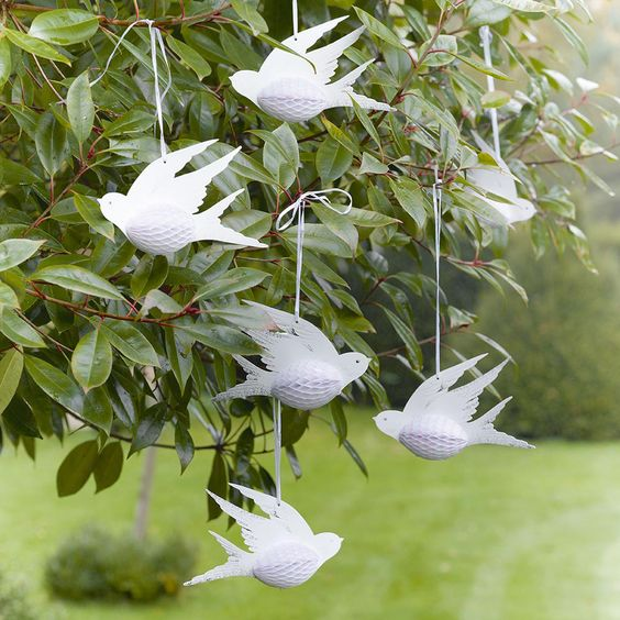 Our stunning honeycomb paper birds are the perfect addition to your wedding décor. For a unique approach to a classic white wedding, decorate the space with these hanging birds.Each pack contains 3 paper birds, 6 inches in size with silver foil and white and pink honeycomb detail.