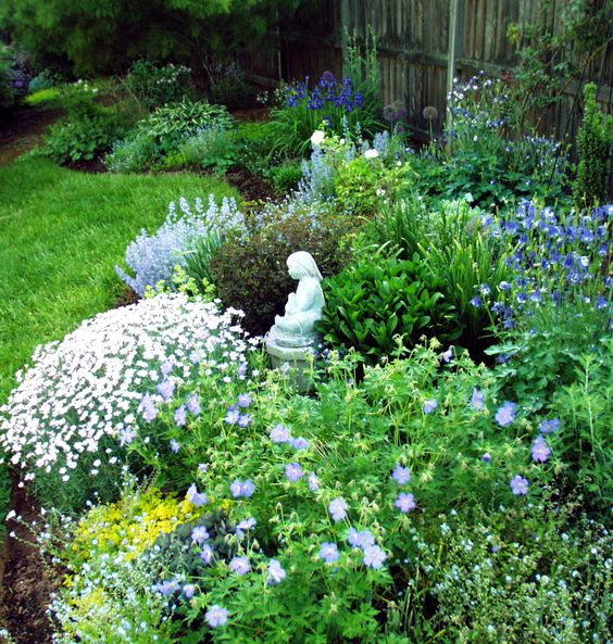 Wendy Kremer's Garden - Mid-may peak bloom. Includes dianthus, geranium, nepeta, siberian iris, and columbines.