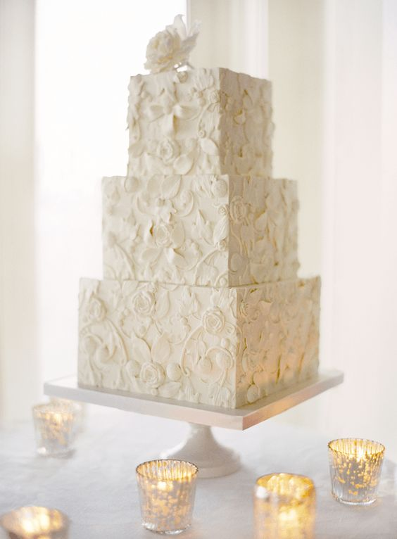 The wedding cake was also designed to match the lace on the bride's gorgeous Monique Lhulilier gown. #Celebstylewed #Decor #Napa #Bridal. @Jason Jones Style Weddings