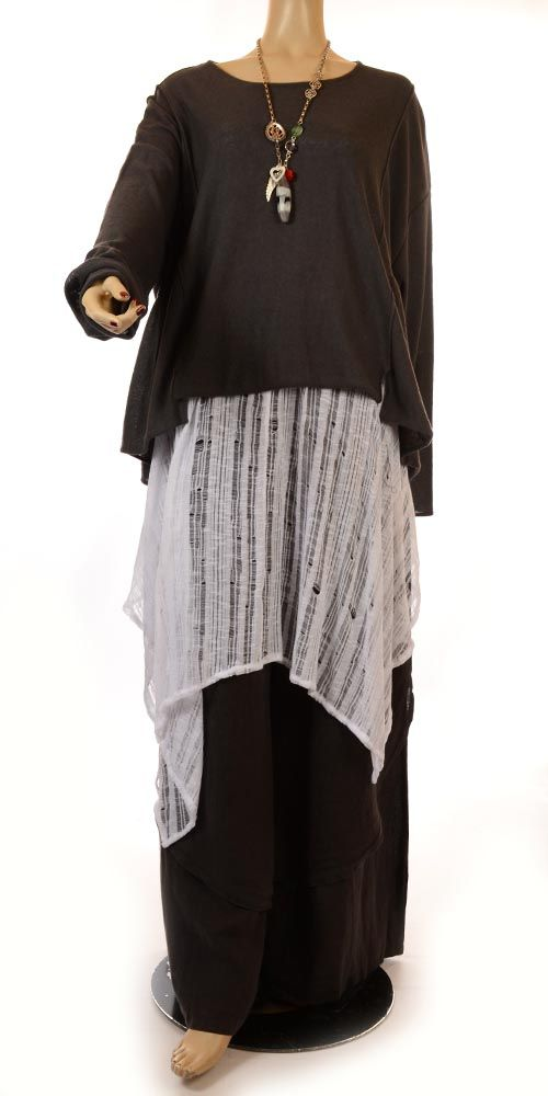 This is from a plus size website (despite the fact the model is clearly not plus size), but the look would work at all sizes. Oversized layered natural colour knit jumpers and dresses.