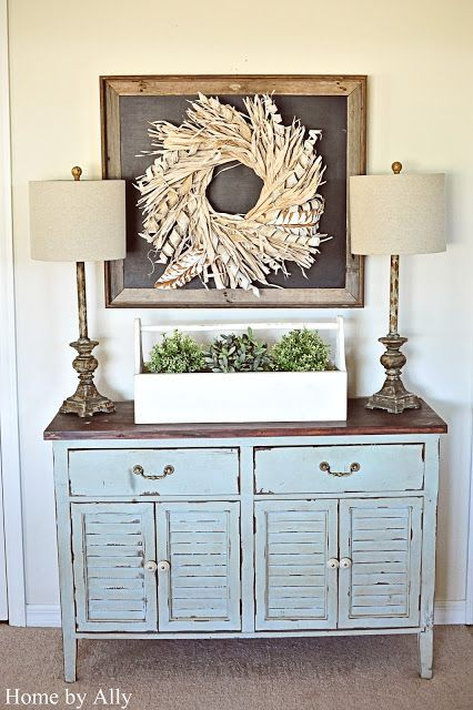 white rustic wreath in a chalkboard styled picture frame