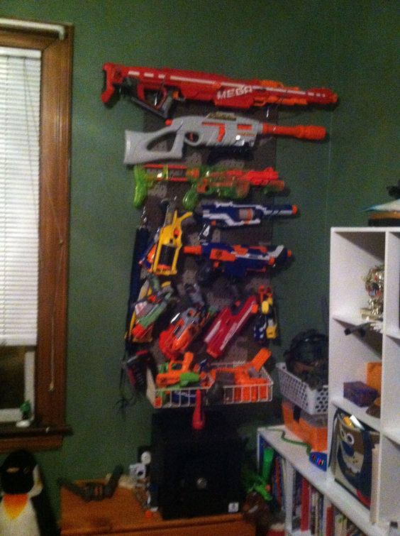 DIY Nerf Gun Rack  Used A Ladder From An Old Bunk Bed. Used Various Hooks,  Wood Screws, And Nails To Mount The Guns. | Crafty | Pinterest | Cristian Y  ...