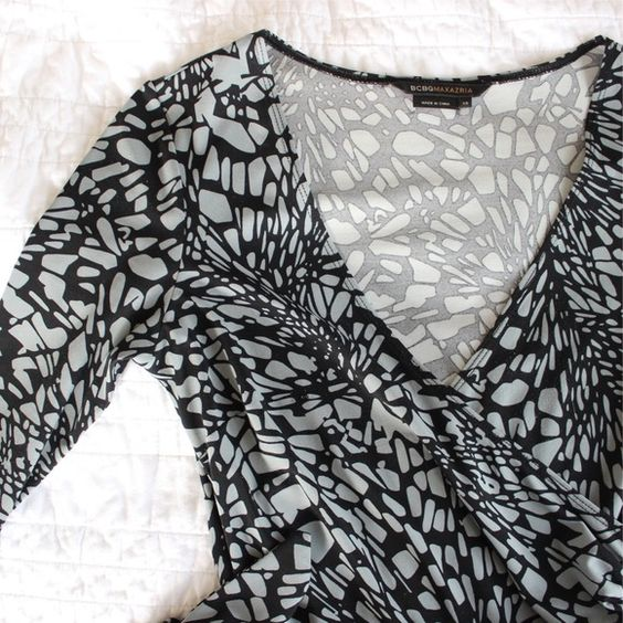 Tie Back Patterned Long Sleeve Dress Beautiful faux wrap dress with a classic geometric gray and black pattern. In excellent used condition. There is a small hole on the belt, which is not visible. Perfect for career wear. Stretchy, and could certainly fit a size small. 94% Polyester, 6% Spandex. Offers always welcome! BCBGMaxAzria Dresses Midi