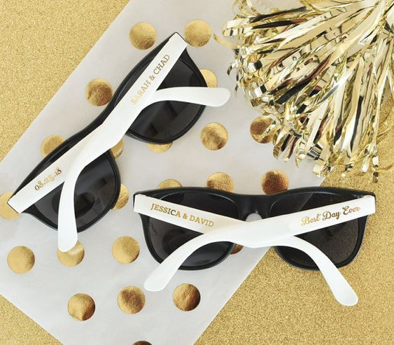 Beach Theme Wedding Favors are perfect for your outdoor beach wedding ceremony! These personalized sunglasses are a great idea for a beach theme bridal shower too! If your ceremony is outdoors place a set of sunglasses on each chair to shade guests from the sun - each black pair of sunglasses with white handles or hot pink handles comes with personalized CLEAR labels printed with either black text or metallic gold text - labels are provided for both sides so for a set of 24 sunglasses you…