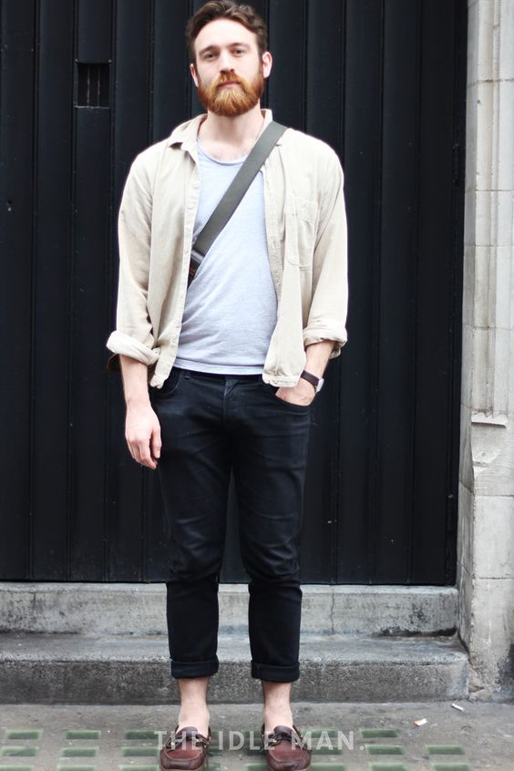 Men's street style | Casual Blues - Take a note from this laid back look by pairing together your black denims with a t-shirt and a light jacket and finish it off with a pair of brown loafers. | Shop the look at The Idle Man