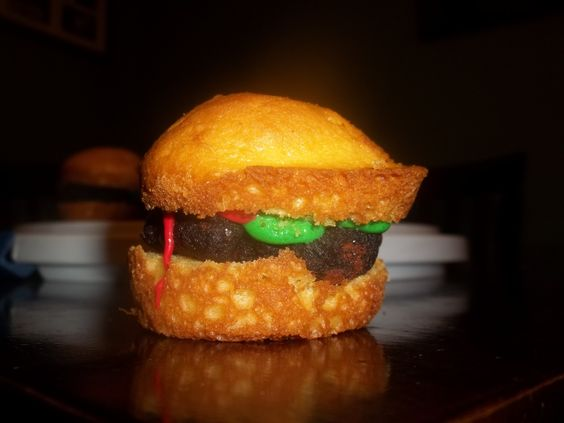 Hamburger Cupcakes!  Cupcake split in two with a brownie in the middle