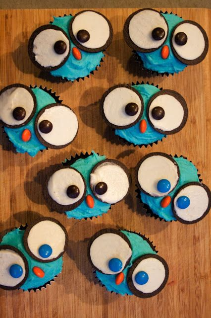 Owl cupcakes! Split Oreo in half and put reeses piece on iced side for the beak.