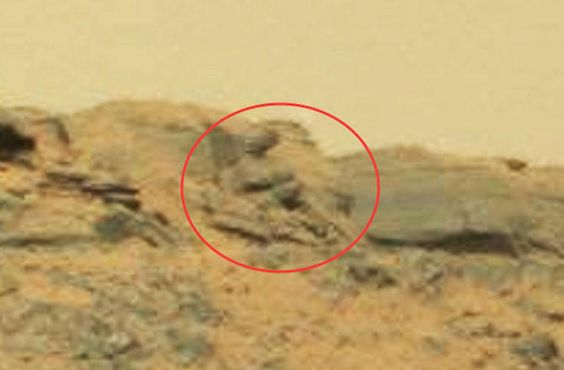 """Buddha on Mars - This """"Martian God"""" statue is actually an excellent example of """"pareidolia,"""" the quirk of the human brain that makes us see human faces where none exist."""
