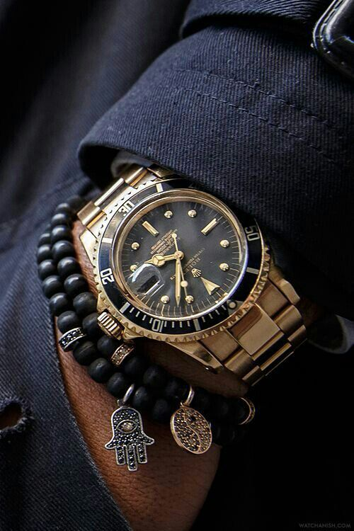 Design: Rolex submariner, watch, clock, style, fashion accessories, gold and black leather.