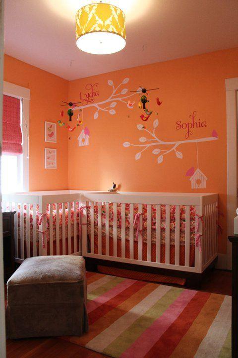 Charming orange nursery for twins