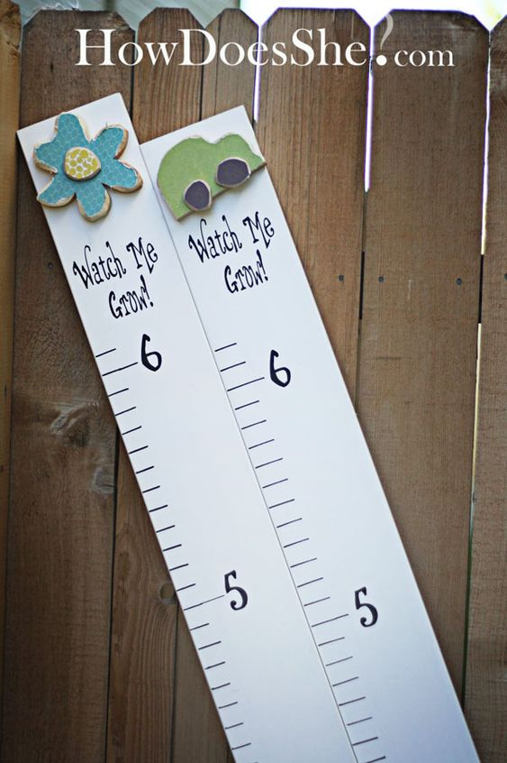 DIY Growth Chart from mdf.  I think I might have to take another look at all of those thin, painted, wood pieces they have next time I'm at Michael's.  They would be so cute going down the side of this.  Maybe even to mark each foot?