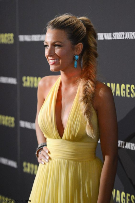 Elegant Blake Lively in Gucci yellow chiffon gown and high fishtail braided ponytail.