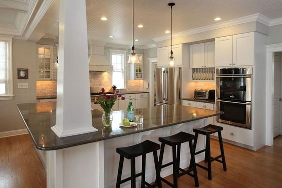 kitchen islands with pillars   Nice white kitchen with big island, beadboard ceiling and subway tile ...