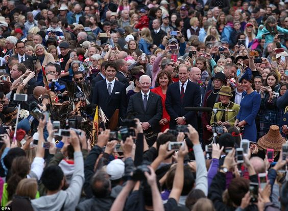 The Duke and Duchess posed alongside Canadian officials as the crowds fought to get in position to get a picture