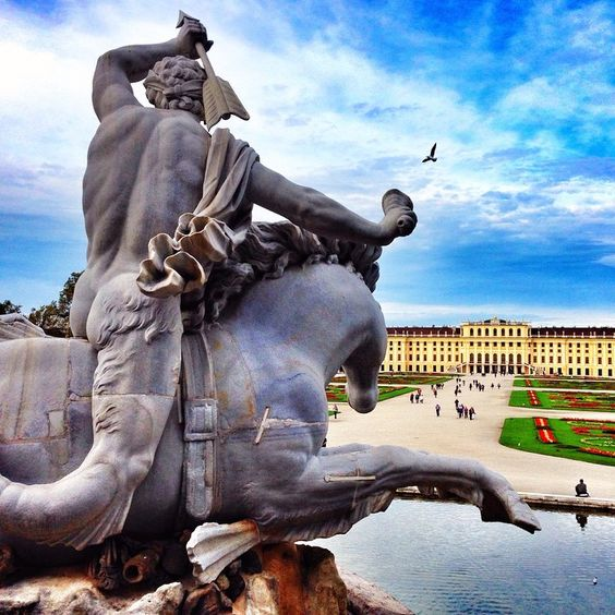 View from the Neptune fountain at Schonnbrunn Palace (Summer Palace of the Hapsburgs right outside of central Vienna). Caught a bird mid-flight. Looks like the statue might get him.