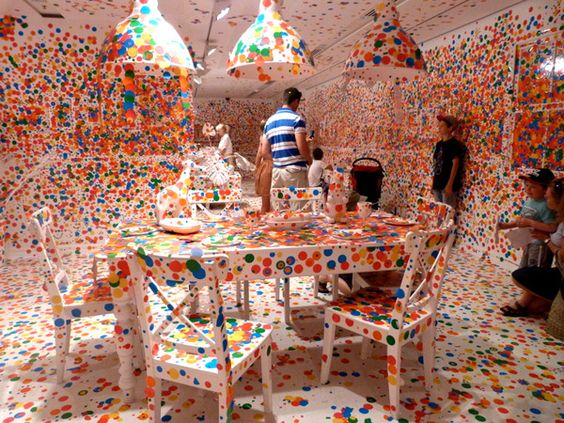 Yayoi Kusama designed a room that was COMPLETELY white and allowed thousands of children who visited the exhibit to place stickers EVERYWHERE. The result is overwhelmingly creative!