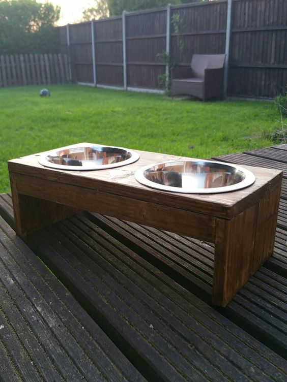 Check out this item in my Etsy shop https://www.etsy.com/uk/listing/280257550/reclaimed-wooden-dog-bowl-holder-with