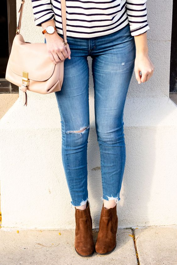 distressed skinny jeans from j. crew with brown suede ankle boots for fall | stripe j. crew top and pink leather crossbody bag | blush leather bag | frayed hem jeans | fall ankle boots