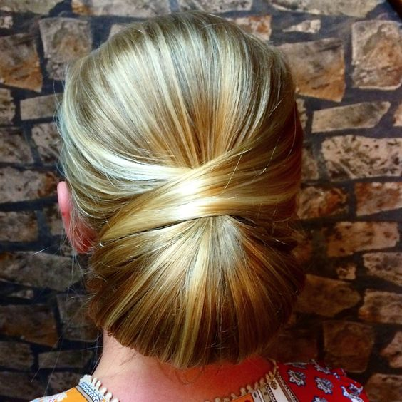 Whitley Lyon of Cowan and Co offers the HOW TO for this sleek and chic chignon the perfect bridal look